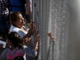 file-photo-a-woman-touches-a-family-member-through-the-border-fence-between-ciudad-juarez-and-el-paso-united-states-after-a-bi-national-mass-in-support-of-migrants-in-ciudad-juarez