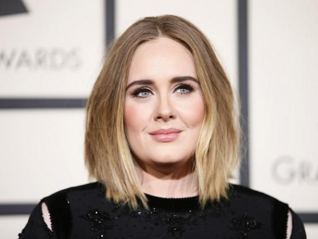 Singer Adele arrives at the 58th Grammy Awards in Los Angeles. PHOTO: REUTERS