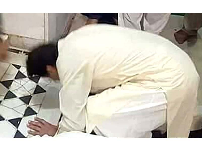 PTI chief Imran Khan appears to be kneeling in prayer, but says he was kissing the ground. SCREENGRAB