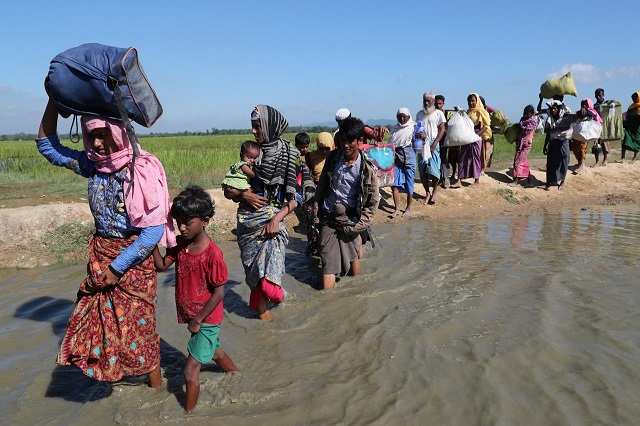 rohingya-refugees-walk-towards-a-refugee-camp-after-crossing-the-border-in-anjuman-para-near-coxs-bazar-2-2-3-2-2
