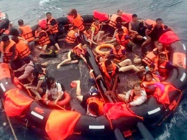 Rescuers still searching for dozens after boat capsizes off Thai resort island