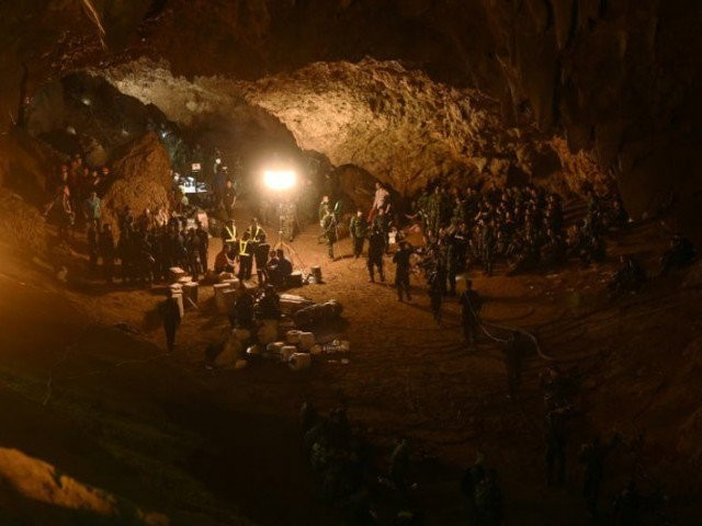 The players remain trapped despite being reached this week by cave-diving rescuers, who released footage of them looking emaciated but calm, some wearing football shirts. PHOTO: AFP