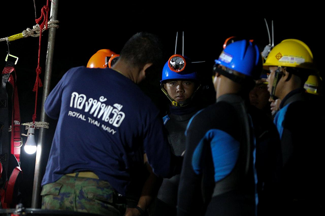 Thai divers gather before they enter to the Tham Luang cave where 12 boys and their soccer coach are trapped in the northern province of Chiang Rai Thailand