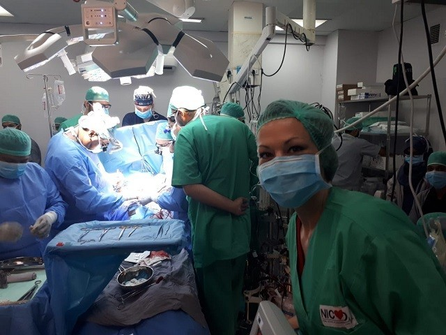 A team of doctors performing Pakistan's first ever mechanical heart transplant at NICVD. PHOTO: NICVD