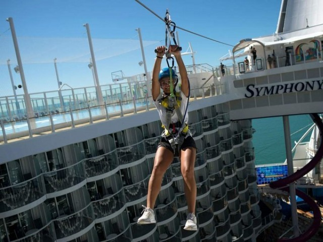 A woman slides down a zip-line aboard a Royal Caribbean's cruise ship. PHOTO: AFP