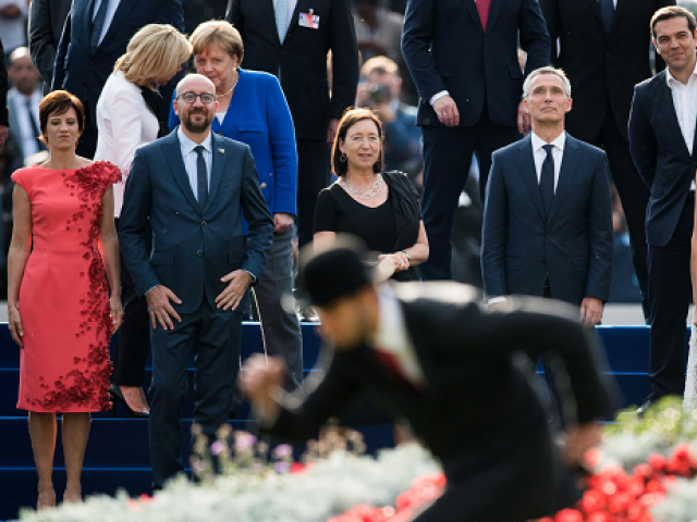 (L/R): PM Michel's partner Amelie Derbaudrenghien , Belgian Prime Minister Charles Michel, First Lady of France Brigitte Macron, Chancellor of Germany Angela Merkel, Stoltenberg's partner Ingrid Schulerud, NATO Secretary General Jens Stoltenberg, Prime Minister of Greece Alexis Tsipras, First Lady of the US Melania Trump and US President Donald Trump watch a show ahead of a working dinner at The Parc du Cinquantenaire - Jubelpark Park in Brussels on July 11, 2018, during the North Atlantic Treaty Organization (NATO) summit. PHOTO: AFP