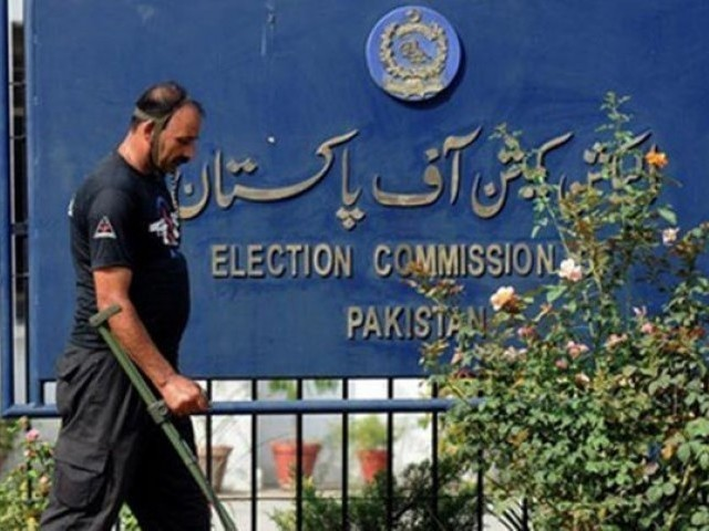 A security man walks outside the Election Commission of Pakistan building in Islamabad. PHOTO: AFP