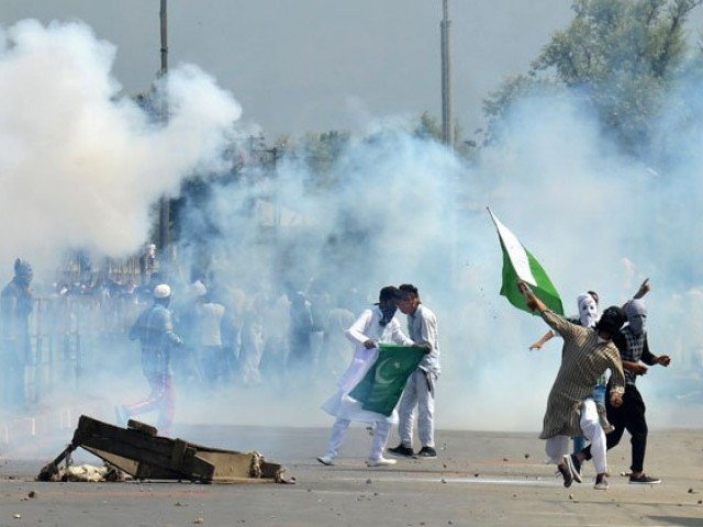 Indian forces hurl tear gas at Kashmiri protesters in Sringar. PHOTO: AFP/FILE