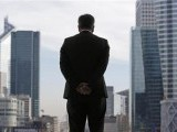a-businessman-is-silhouetted-as-he-stands-under-the-arche-de-la-defense-in-the-financial-district-west-of-paris-2-2-2-2-2