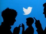 file-photo-people-holding-mobile-phones-are-silhouetted-against-a-backdrop-projected-with-the-twitter-logo-in-warsaw-4