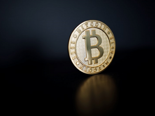 A Bitcoin (virtual currency) coin is seen in an illustration picture taken at La Maison du Bitcoin in Paris, France, June 23, 2017. PHOTO: REUTERS