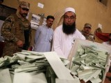 An election official counts ballots after polls closed during the general election in Islamabad. PHOTO: REUTERS