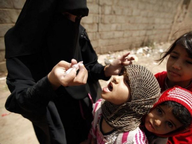 Representational image of a health worker administering drops of polio vaccine to children. PHOTO: REUTERS