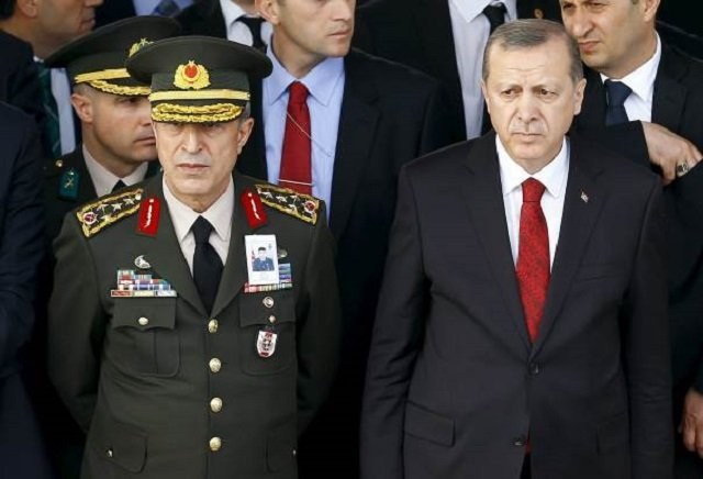 Turkish President Tayyip Erdogan (R) and Chief of Staff General Hulusi Akar. PHOTO: REUTERS/ FILE