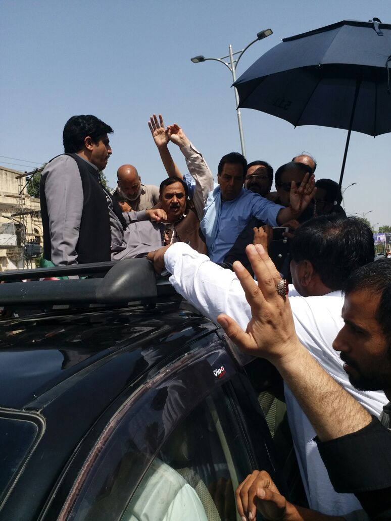 Capt (retd) Safdar Awan makes his way to Rawalpindi. PHOTO: EXPRESS