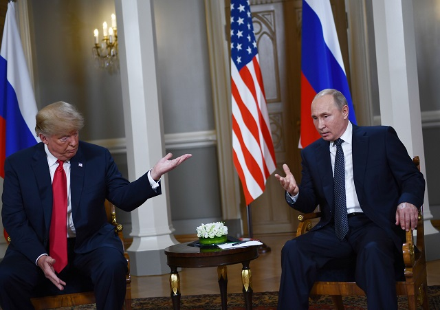 Trump tries to calm political storm over Putin summit, says he misspoke