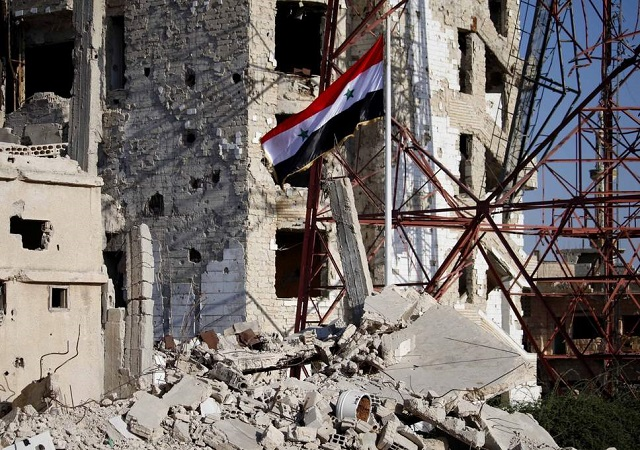 Rebels surrender and governments raise flag over Deraa, birthplace of revolt. PHOTO: AFP/ FILE