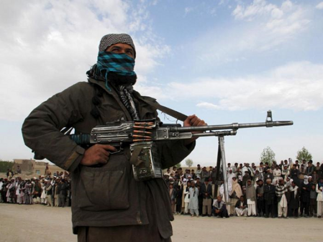 A Taliban insurgent is pictured here. PHOTO: REUTERS