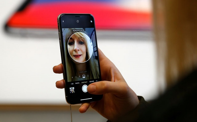 file-photo-a-customer-uses-the-new-face-recognition-software-on-the-new-iphone-x-inside-the-apple-store-in-regents-street-in-london