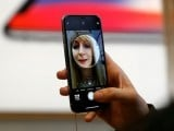 file-photo-a-customer-uses-the-new-face-recognition-software-on-the-new-iphone-x-inside-the-apple-store-in-regents-street-in-london-2