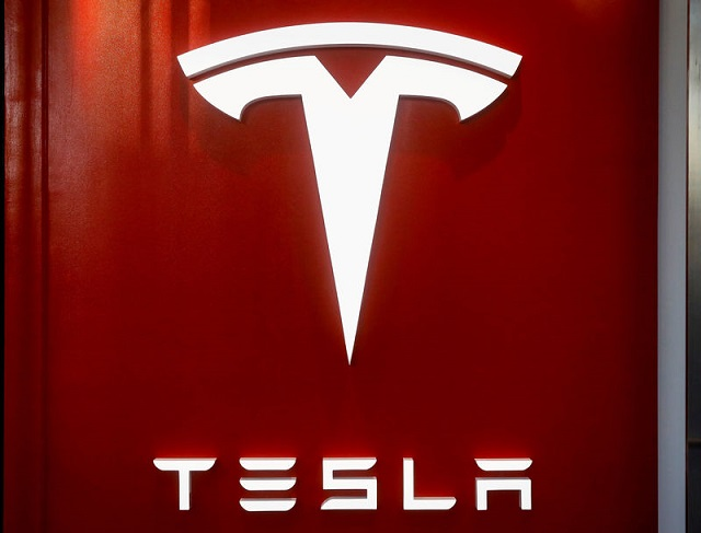 The Tesla logo is seen at the entrance to Tesla Motors' new showroom in Manhattan's Meatpacking District in New York City, US, December 14, 2017. PHOTO: REUTERS
