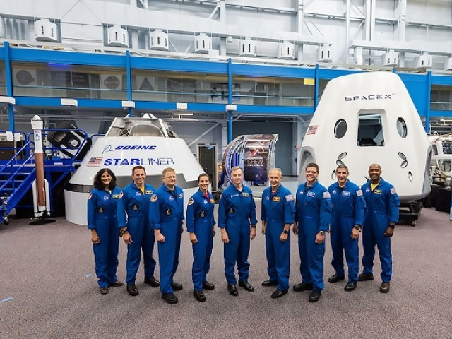 This handout photograph obtained August 3, 2018 courtesy of NASA shows the first US astronauts who will fly on American-made, commercial spacecraft . PHOTO: AFP