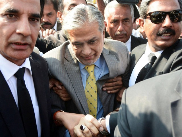 Former finance minister Ishaq Dar appearing before an accountability court in Islamabad. PHOTO: EXPRESS