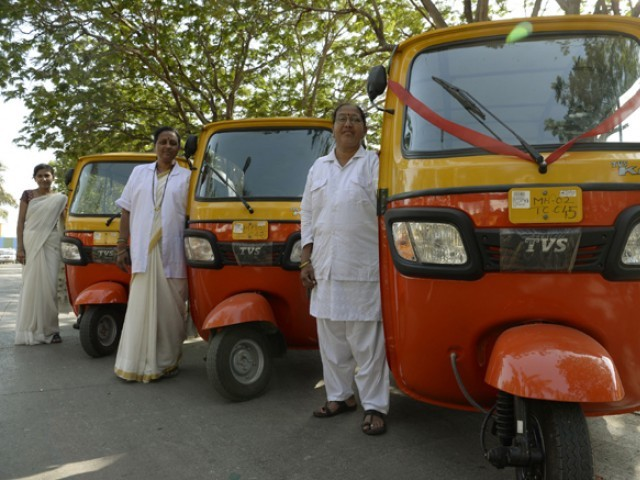This photo taken on March 20, 2017 shows female Indian rickshaw drivers posing for a picture ahead of their vehicle registration process in Mumbai. They are one of Mumbai's first female auto drivers to make use of a government scheme aimed at empowering women. PHOTO: AFP