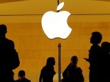 customers-walk-past-an-apple-logo-inside-of-an-apple-store-at-grand-central-station-in-new-york