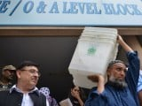 a-pakistani-election-official-carries-ballot-boxes-at-a-distribution-centre-in-islamabad-on-july-24-afp