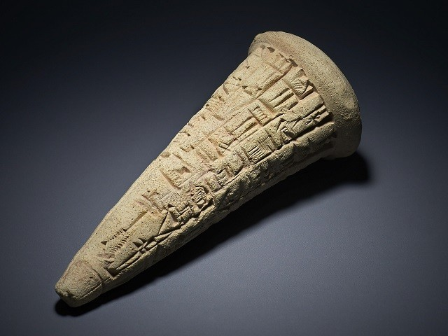 A handout picture released by the British Museum in London on August 9, 2018 shows a Sumerian clay cone, dating to around 2200BC. PHOTO: AFP