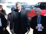 bishop-santiago-silva-president-of-the-chiles-episcopal-conference-walks-next-to-general-secretary-of-the-episcopal-conference-bishop-fernando-ramos-as-they-arrive-at-a-news-conference-at-punta
