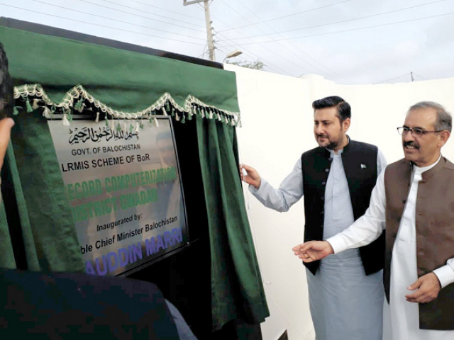 Interim Balochistan Chief Minister Alauddin Marri unveils the plaque of the Land Record Computerisation Building in Gwadar. CM Marri is accompanied by Chief Secretary Dr Akhter Nazeer. PHOTO: EXPRESS