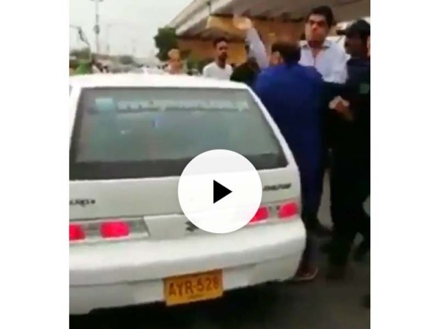 The PTI lawmaker apologises for his actions saying the viral video does not show the motorist verbally abusing and pushing him. SCREENGRAB