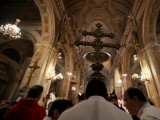 file-photo-members-of-the-church-hold-a-cross-during-a-mass-at-the-santiago-cathedral-in-santiago