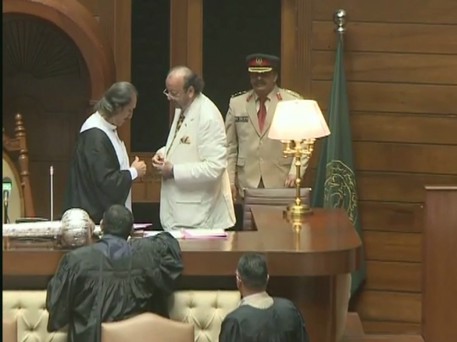 Speaker of the Sindh Assembly, Agha Siraj Durrani with presiding officer Nadir Magsi, a PPP MPA. SCREENGRAB