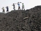 workers-walk-on-a-heap-of-coal-at-a-stockyard-of-an-underground-coal-mine670-2-2-3-3-2-2