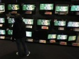 a-customer-looks-at-television-screens-3