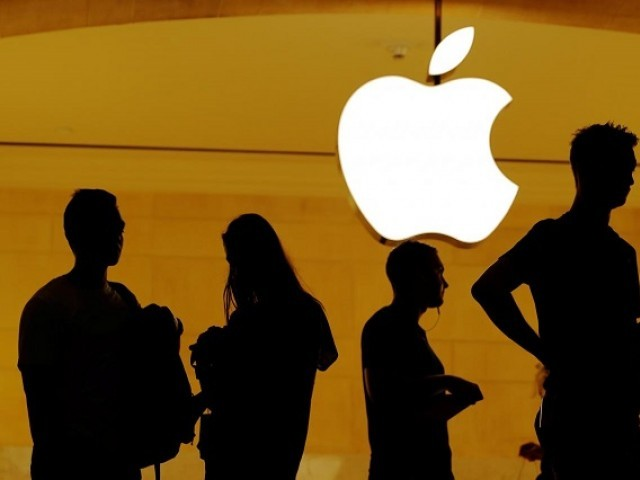 Customers walk past an Apple logo inside of an Apple store at Grand Central Station in New York US