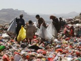 people-collect-recyclable-items-from-piles-of-rubbish-at-a-landfill-site-on-the-outskirts-of-sanaa