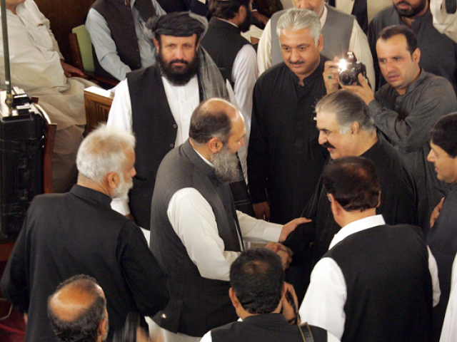Former chief minister Sanaullah Zehri congratulates Jam Kamal Khan on being elected as the provincial chief in the Balochistan Assembly. PHOTO: EXPRESS