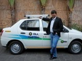 bhavish-aggarwal-ceo-and-co-founder-of-ola-an-app-based-cab-service-provider-poses-in-front-of-an-ola-cab-in-mumbai-2
