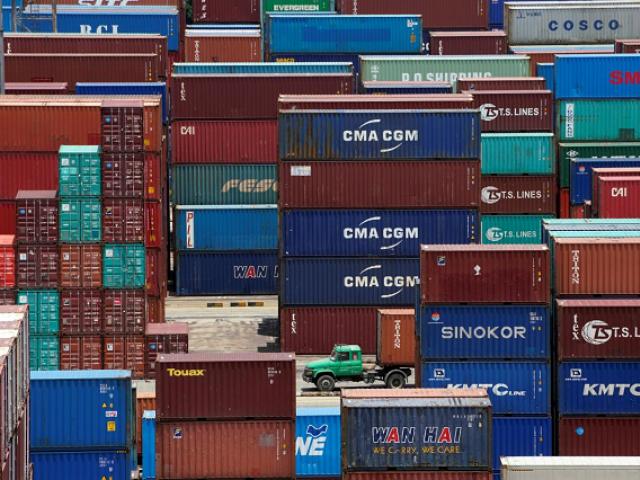 Shipping containers are seen at a port in Shanghai, China July 10, 2018. PHOTO: REUTERS