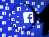 file-photo-a-man-poses-with-a-magnifier-in-front-of-a-facebook-logo-on-display-in-this-illustration-taken-in-sarajevo