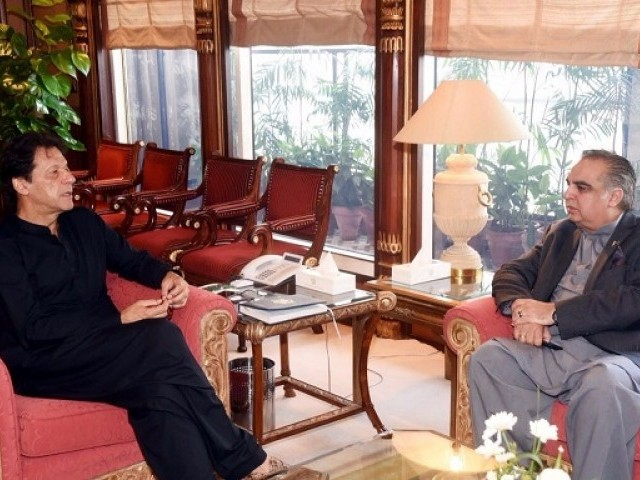 Prime Minister Imran Khan's meeting with Governor Sindh Imran Ismail. PHOTO: EXPRESS TRIBUNE