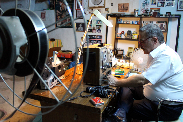Abdel Qader al Ayoubi works on a recorder in his basement. PHOTO: AFP