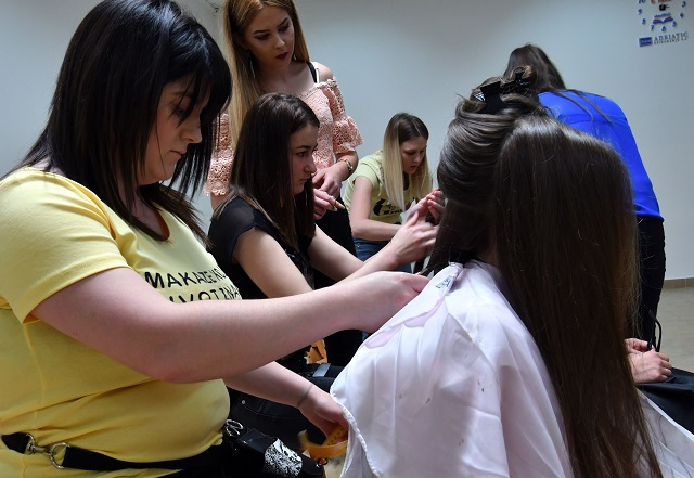 "Hairdressers prepare the hair of young donors before snipping off some as part of the ""My Hair Your Hair"" campaign in Sarajevo on May 25, 2018. PHOTO: AFP"