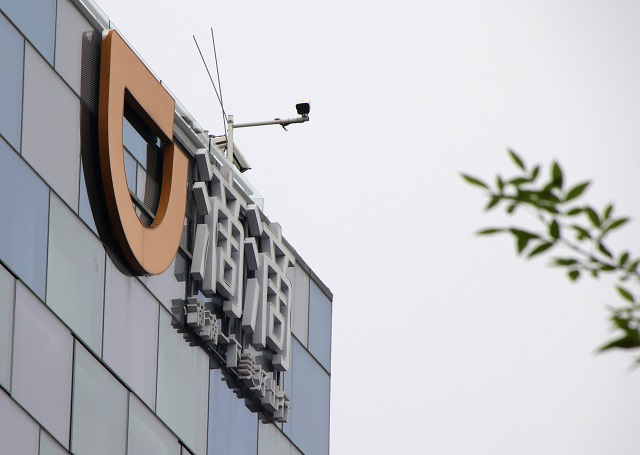 Logo of Didi Chuxing is seen at its headquarters building in Beijing, China August 28, 2018. PHOTO: REUTERS