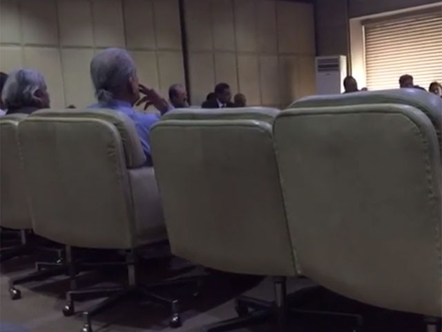 The former chairman Senate is seen apparently smoking a cigar in the meeting of the Senate committee. VIDEO SCREEN GRAB