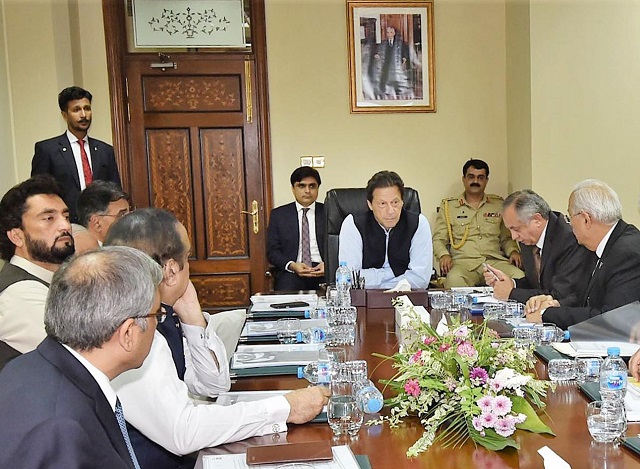 PM Imran Khan chairs a high-level meeting in Islamabad on Monday. PHOTO: PID
